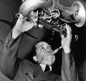 Lester Young playing tenor saxophone ca. 1940.