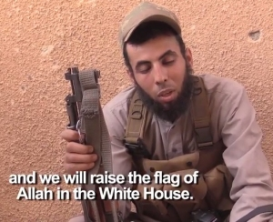 ISIS fighter threatening America. Clip from a video recording 2014.