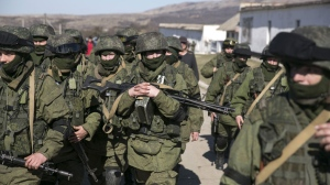 Unmarked Russian troops occupy Crimea, March 2014. Baz Ratner/Reuters.
