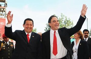 American Hollywood producer Oliver Stone (right) with his late revolutionary hero, Hugo Chavez (left). Nicolas Maduro, the current socialist leader of Venezuela is shown in the right background.